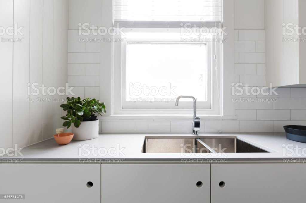 Close up details of contemporary white apartment kitchen stock photo
