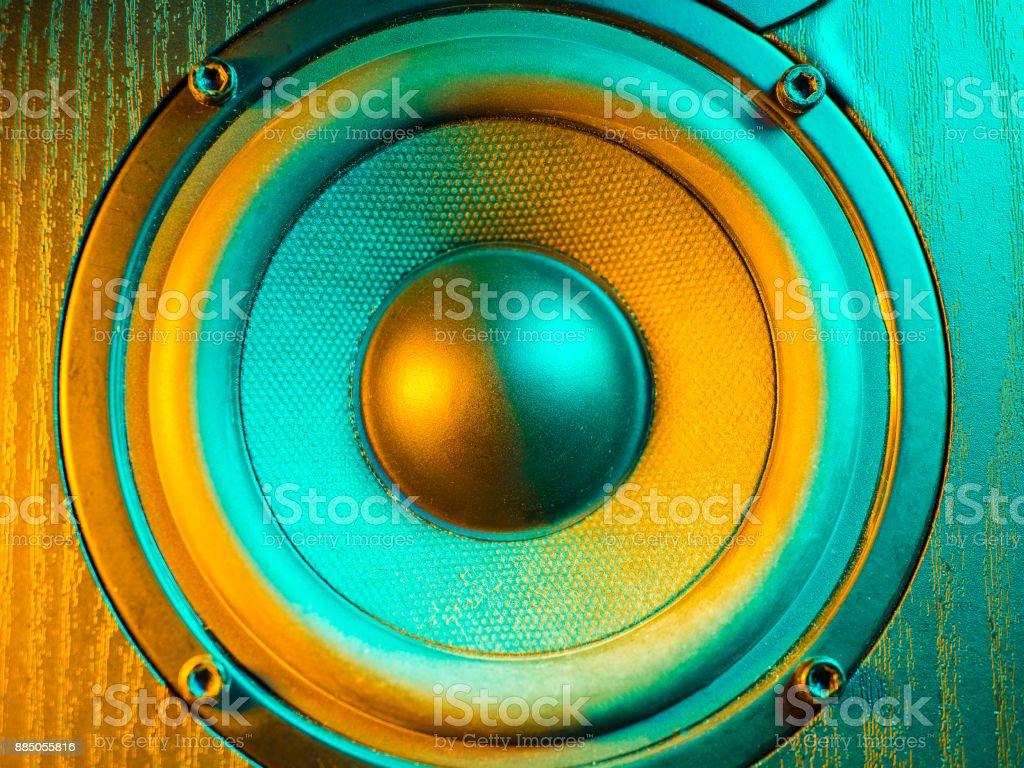 Close up details of loudspeaker woofer and tweeter driver. Colorful orange led light stock photo