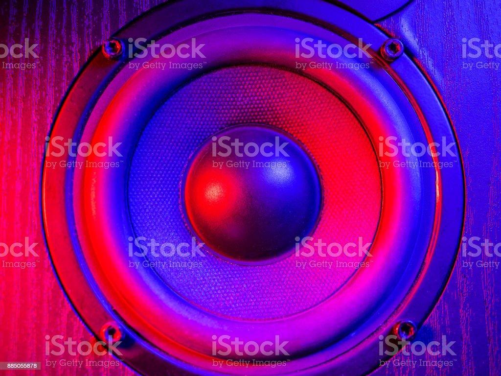 Close up details of loudspeaker woofer and tweeter driver. Colorful violet blue led light stock photo