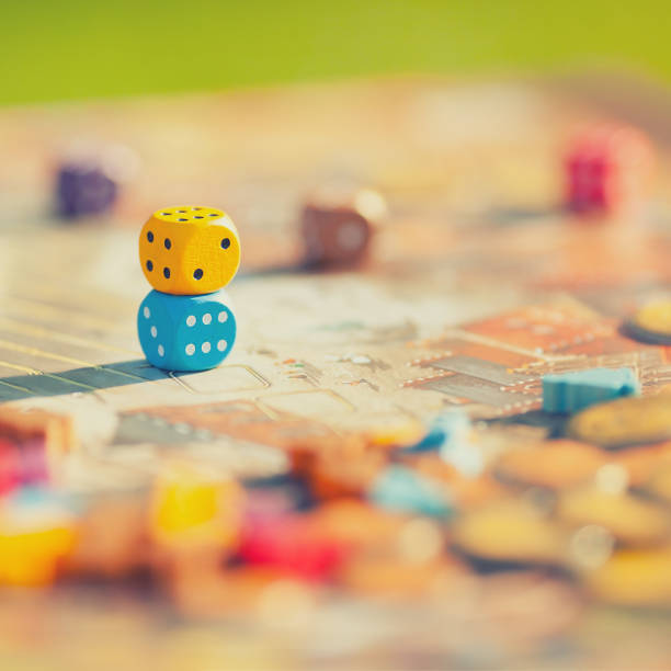 Close up: dices at the table with Board game. stock photo
