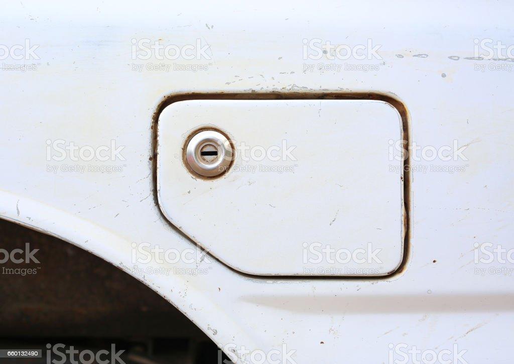 Close up dirty car gasoline fill cap stock photo