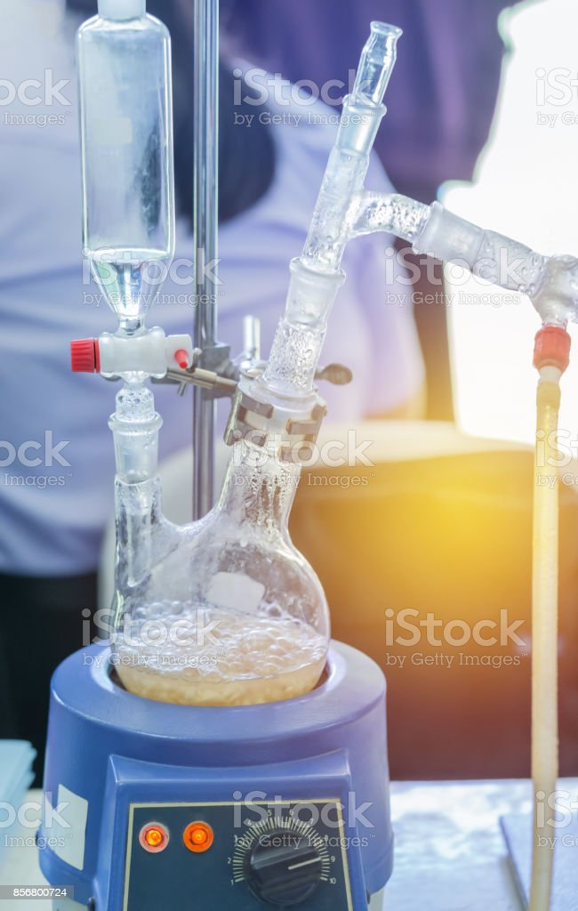 close up distillation set flask two neck equipment for separating the component substances from liquid mixture with evaporation and condensation stock photo