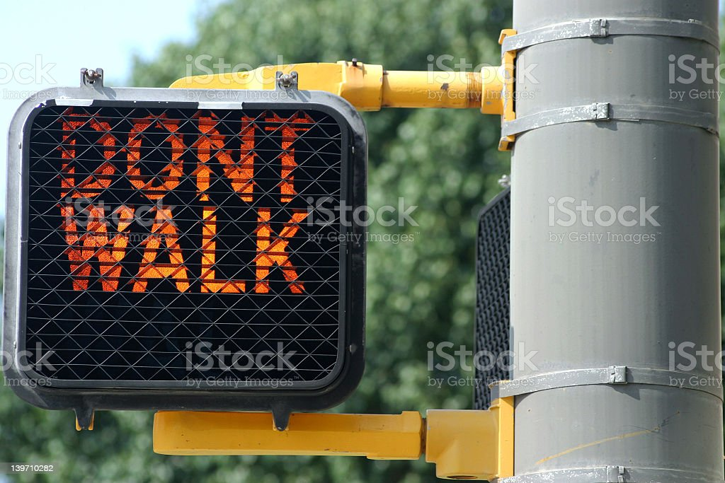 Close up Don't Walk sign on a clear day  stock photo