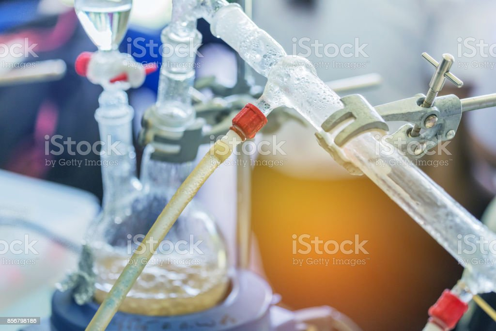 close up dropping funnels of distillation set is separating the component substances from liquid mixture stock photo