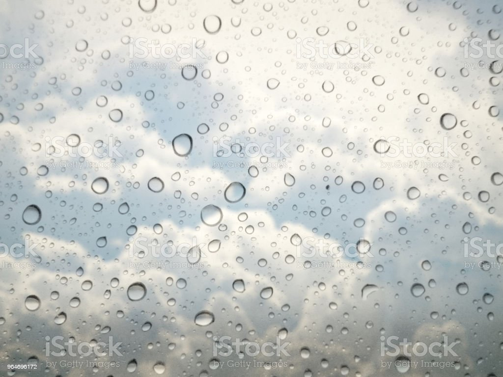 close up drops of rain on glass background. sky and cloud out of focus royalty-free stock photo