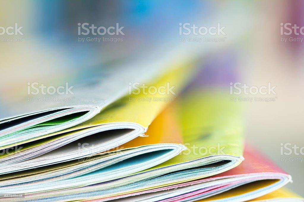 Close up edge of colorful magazine stacking - Royalty-free Beyaz Stok görsel