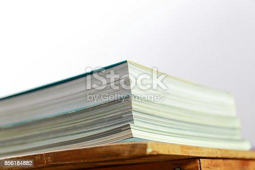 839809942istockphoto Close up edge of colorful magazine stacking 856184882