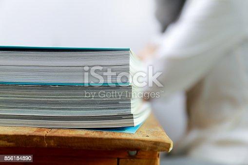 839809942istockphoto Close up edge of colorful magazine stacking 856184890