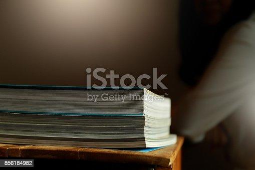 839809942istockphoto Close up edge of colorful magazine stacking 856184982