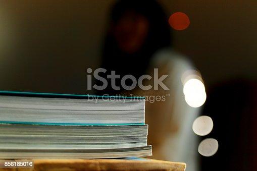 839809942istockphoto Close up edge of colorful magazine stacking 856185016