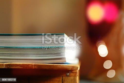 839809942istockphoto Close up edge of colorful magazine stacking 856185018