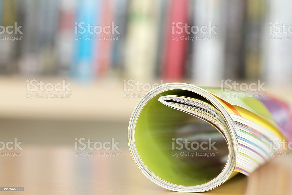 Close up edge of colorful magazine stacking roll stock photo