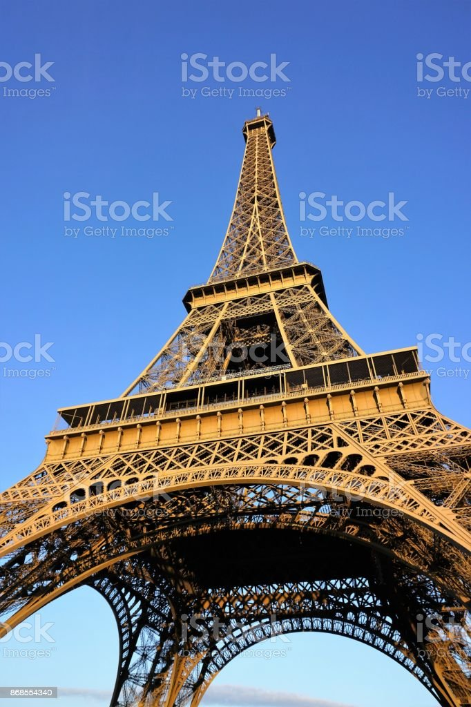 Close up Eiffel Tower in sunny summer day with the clear blue sky background...Paris,France stock photo