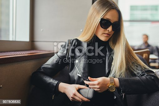 1047058184 istock photo Close up electronic cigarette with case and blur girl on background 937808830