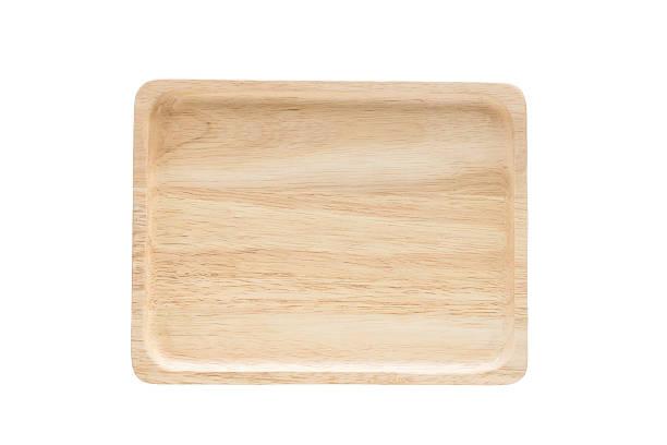 Close up empty flat wooden dish isolated on white background. stock photo