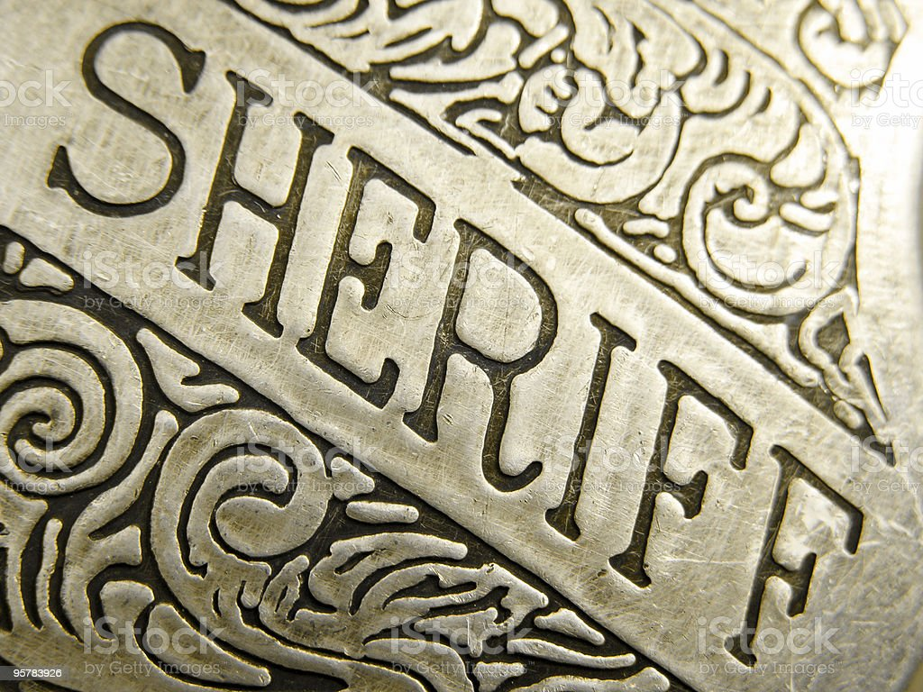 Close Up Engraving on Sheriff Badge royalty-free stock photo
