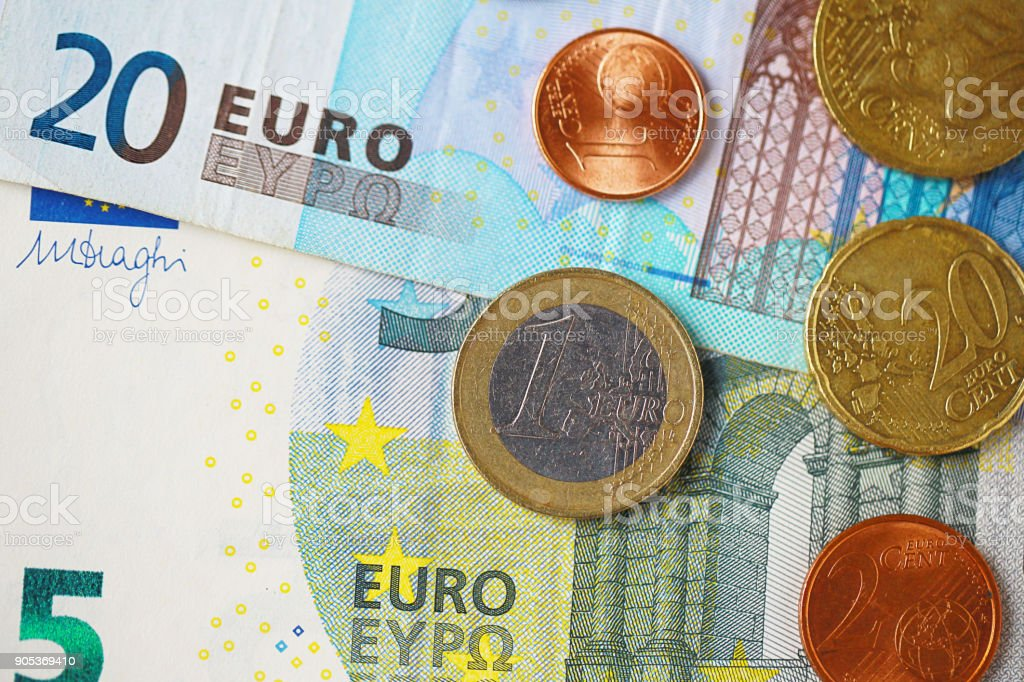 Close up euro coins on the euro banknotes. image for background, wallpaper and copy space. stock photo