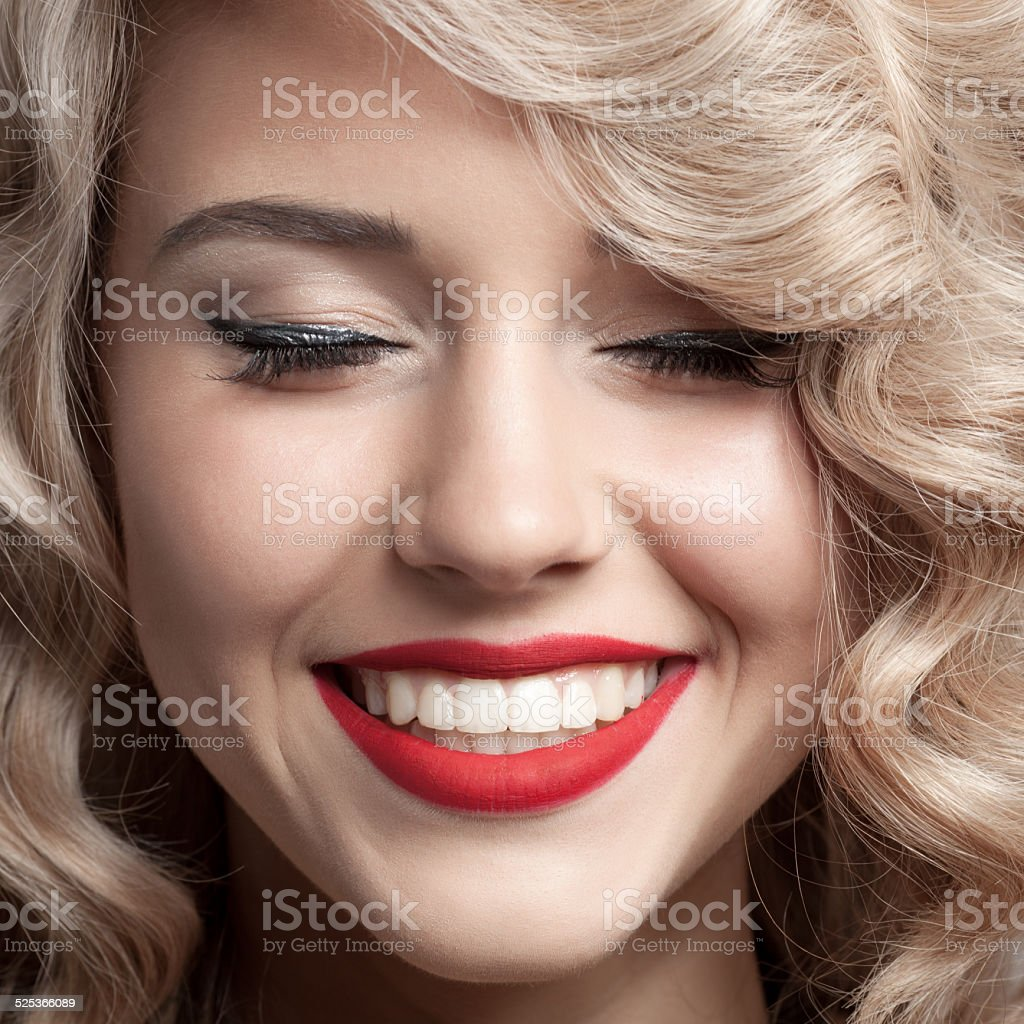 Close up face of beautiful Woman. Healthy Curly Hair. stock photo