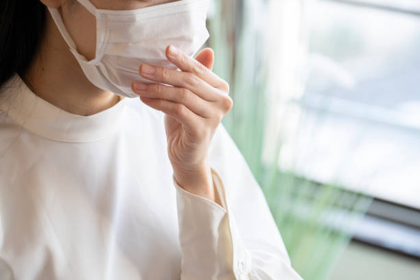 Close up face of young woman wearing mask stock photo
