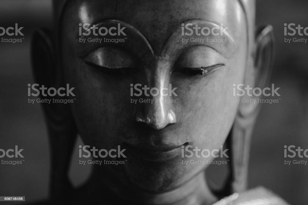 close up face on buddha head. stock photo