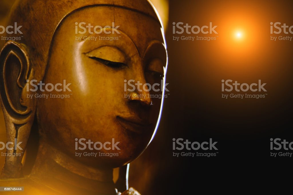 close up face on buddha head statue . stock photo