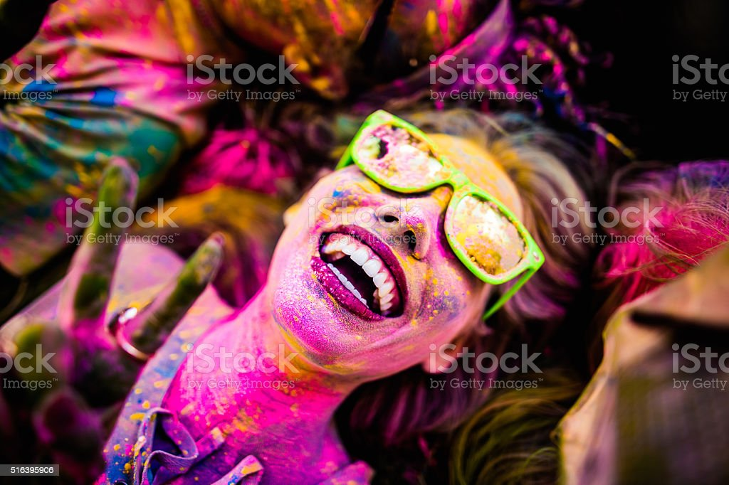 Close up Face Shot of Girl Covered in Holi Powder stock photo