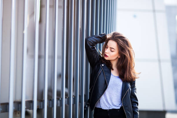 Close up fashion street stile portrait of pretty girl in fall casual outfit Beautiful brunette posing outdoor. stock photo