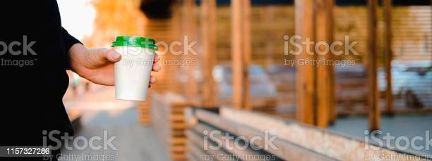 Close up female hand holding paper cup of coffee on background of the picture id1157327286?b=1&k=6&m=1157327286&s=612x612&h=to0fnsnarncwwggfkprycix7v2u y5sjih1wkjman98=