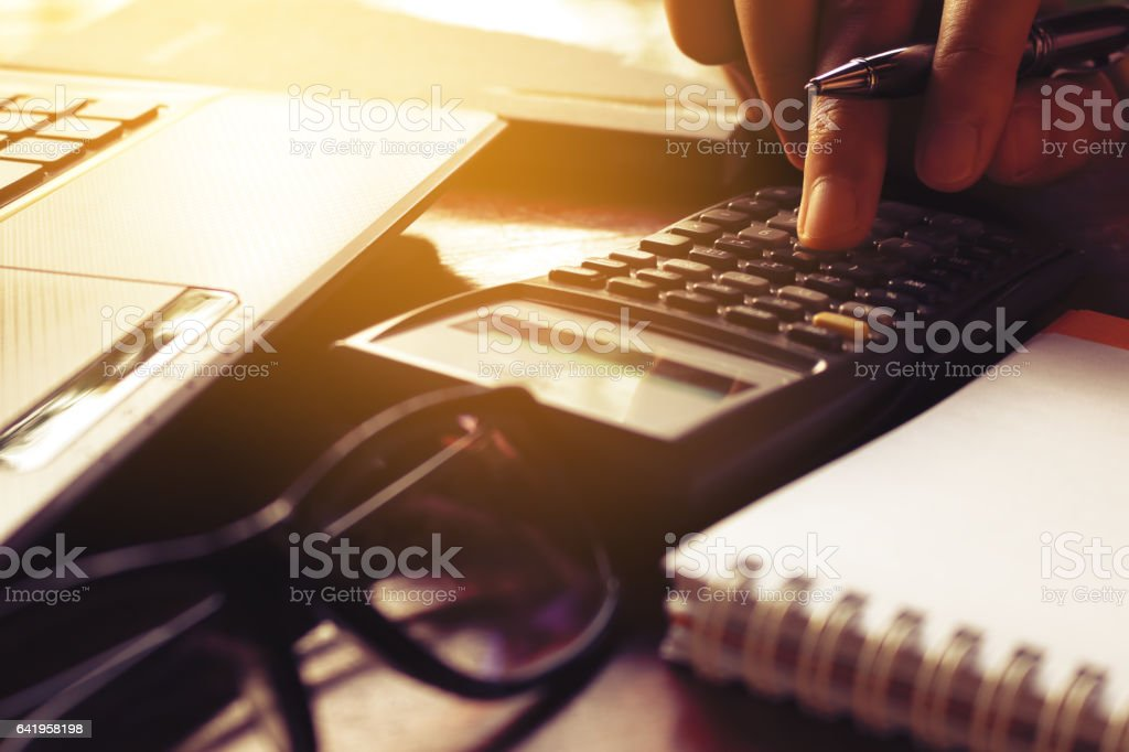 Close up finger of woman calculate about cost on table stock photo