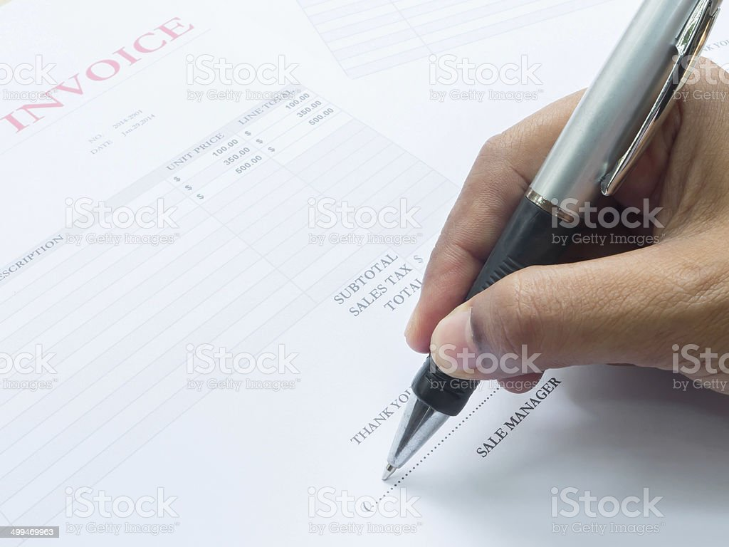 Close up fingers  holding a pen to sign on  document stock photo