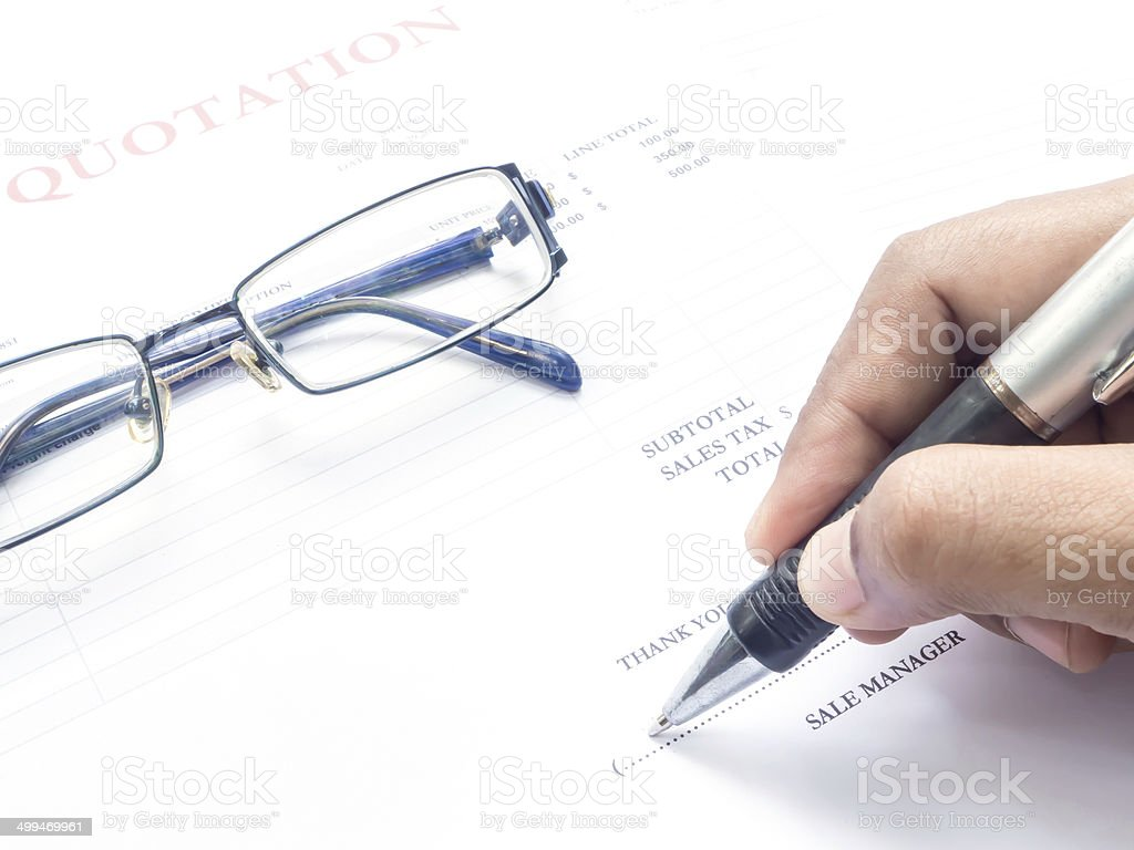 Close up fingers  holding a pen to sign stock photo