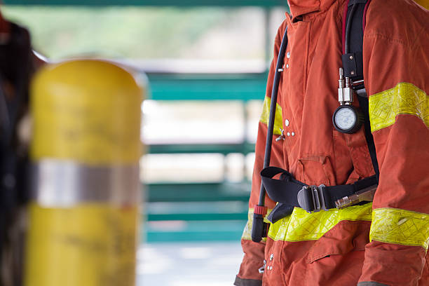 close up fireman in fire fighting protection suit and equipment – Foto