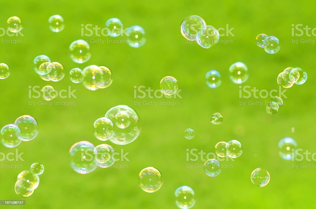 Close up Floating Bubbles  on green background in summer royalty-free stock photo