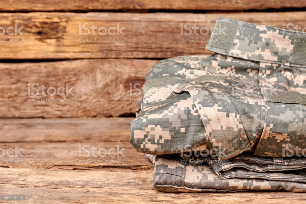 Close up folded military cilothes. stock photo