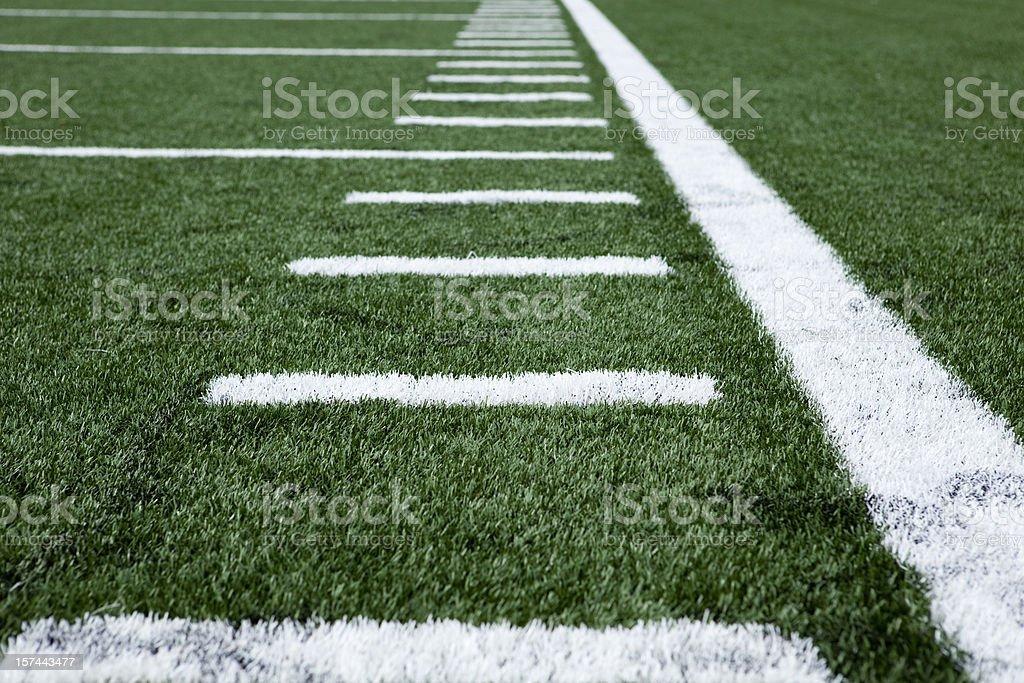Close up football stadium artificial grass and markings stock photo