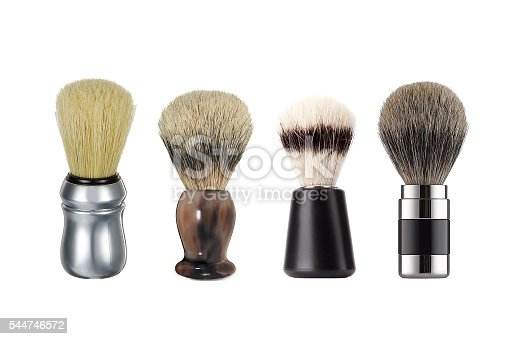 istock Close up four different shaving brushes isolated 544746572