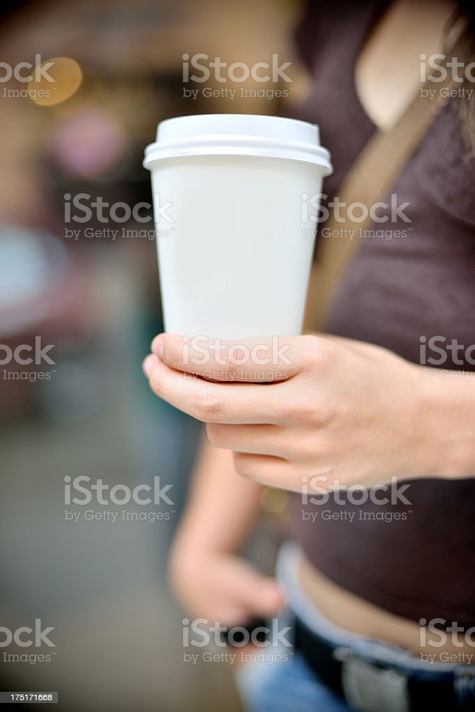 Close up from a hand with coffe to go cup stock photo