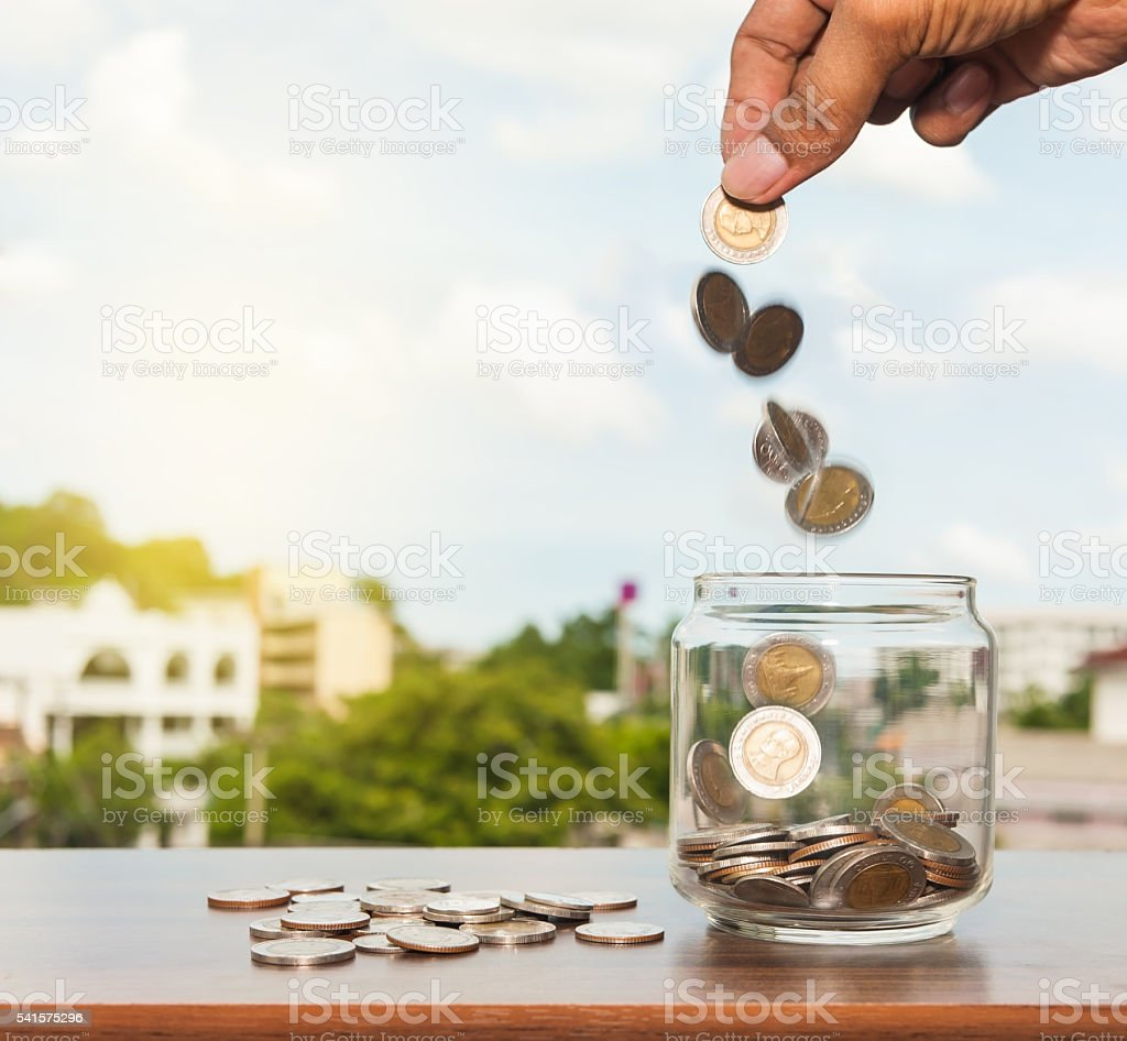 Close up glass bottle with hand stock photo