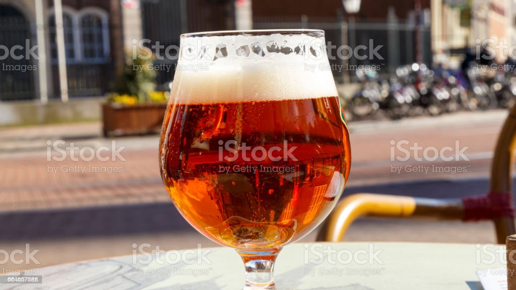 Close up glass of beer view with the bubbles stock photo