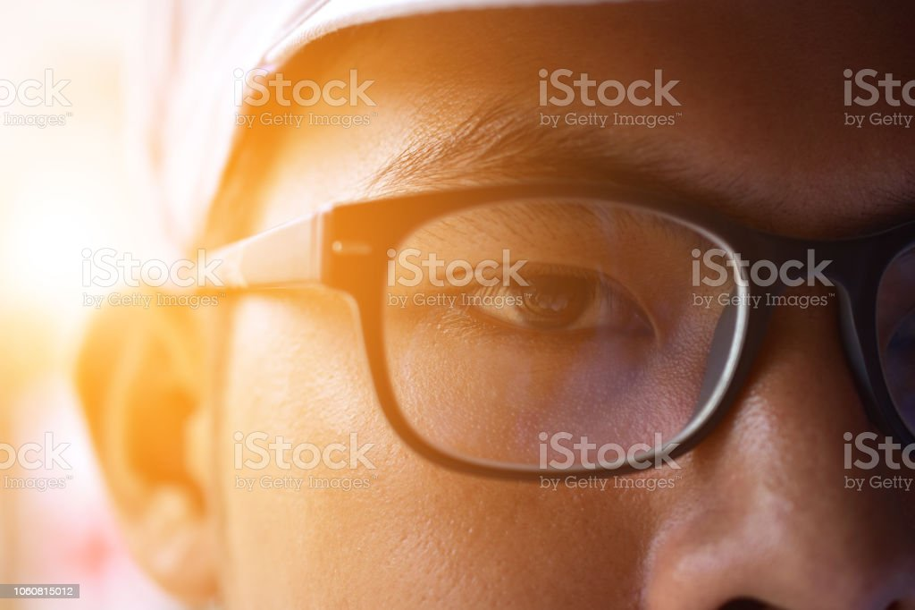 Close up glasses and eye human body part