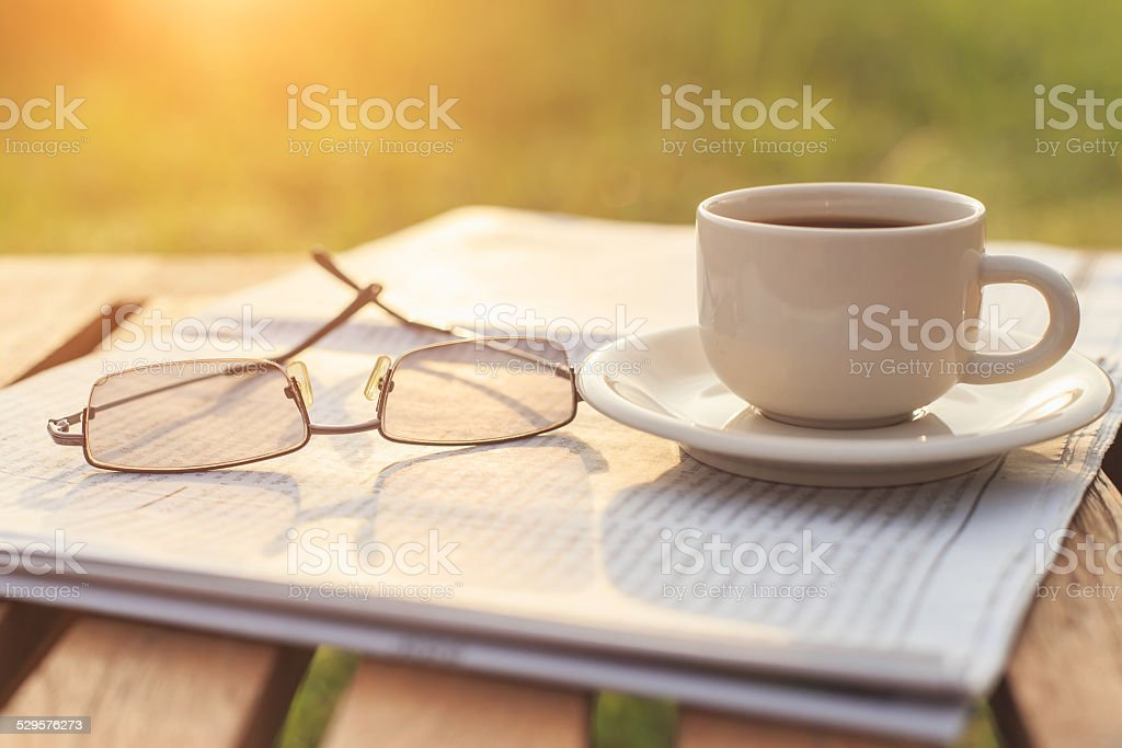 Close up glasses on newspaper and Coffee on the table stock photo