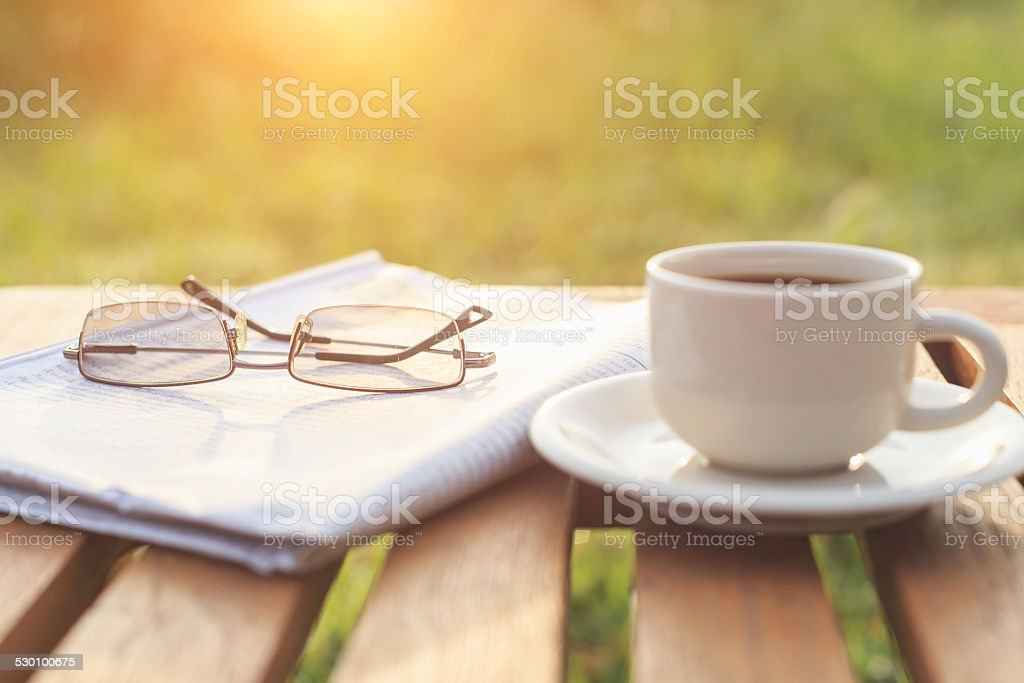 Close up glasses on newspaper and Coffee stock photo