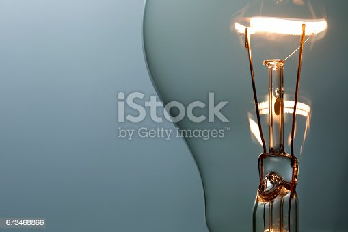 istock Close up glowing light bulb 673468866