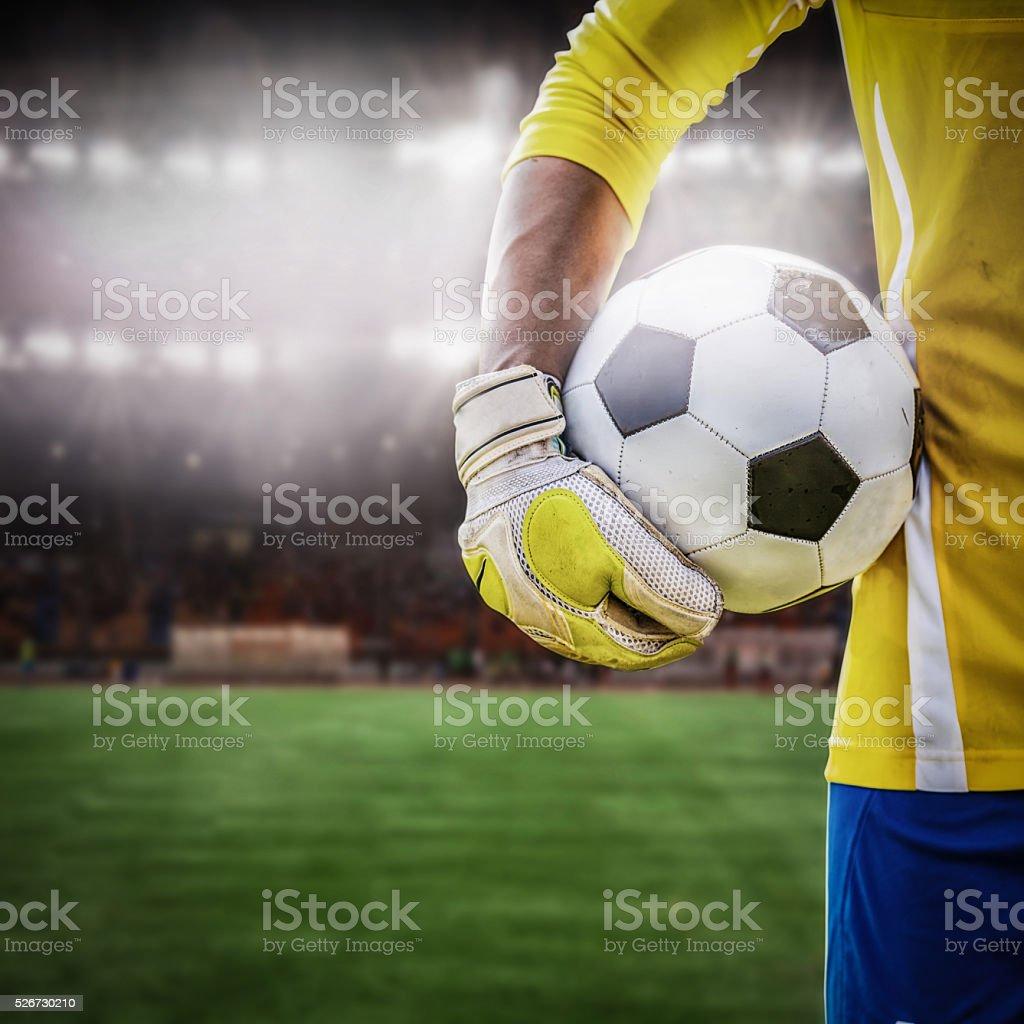 close up goalkeeper holding soccer ball stock photo
