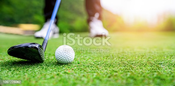 Close up golf ball on green grass field. sport golf club