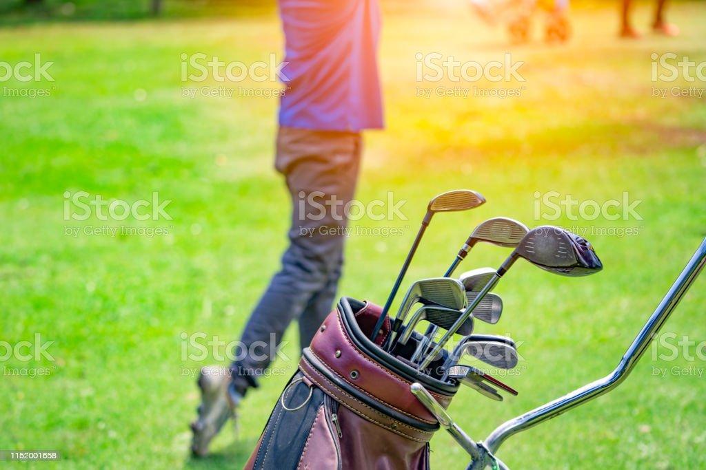 Close Up Golf Club And Bag On Blured Leg Golfer Swing On