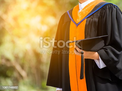 istock Close up Graduate holding a hat. Concept sucess education in University with copy space. 1061746932