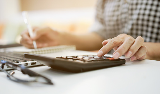 istock close up grandmother hand press on calculator for counting about monthly expense or planning money management after retired concept 1094458358