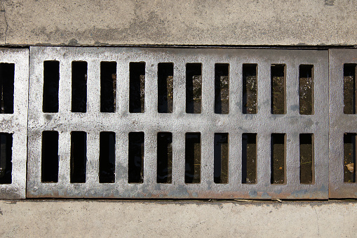 Close up Grille drain of sewer around the street or walkway . Water recirculation system. Wastewater treatment.
