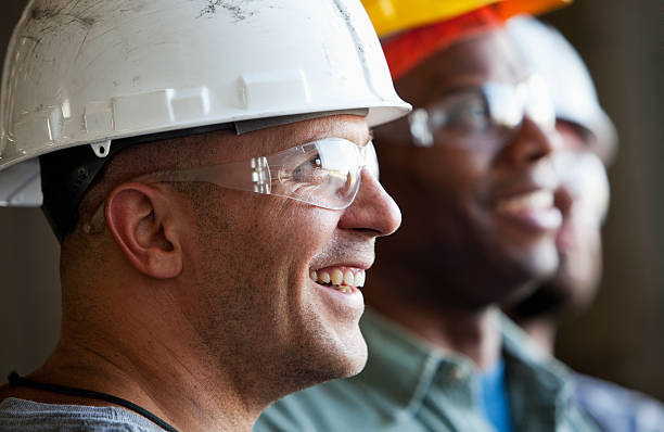 close up group of construction workers - manufacturing occupation stock photos and pictures